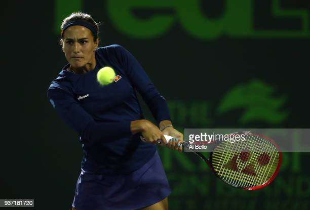 Monica Puig of Puerto Rico plays a shot against Caroline Wozniaki of Denmark during Day 5 of the Miami Open at the Crandon Park Tennis Center on...