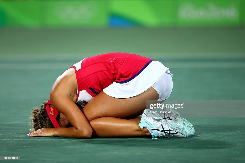 Monica Puig of Puerto Rico reacts after defeating Angelique Kerber of Germany in the Women's Singles Gold Medal Match on Day 8 of the Rio 2016 Olympic Games at the Olympic Tennis Centre on August 13, 2016 in Rio de Janeiro, Brazil. Puig defeated Kerber 6-4, 4-6, 6-1.