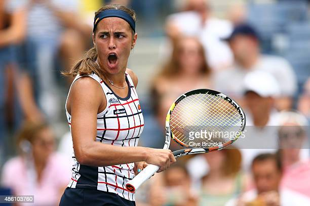 Monica Puig of Puerto Rico reacts against Venus Williams of the United States during her Women's Singles First Round match on Day One of the 2015 US...