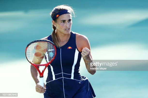 Monica Puig of Puerto Rico reacts during her match against Caroline Garcia of France during Day 4 of the Connecticut Open at Connecticut Tennis...