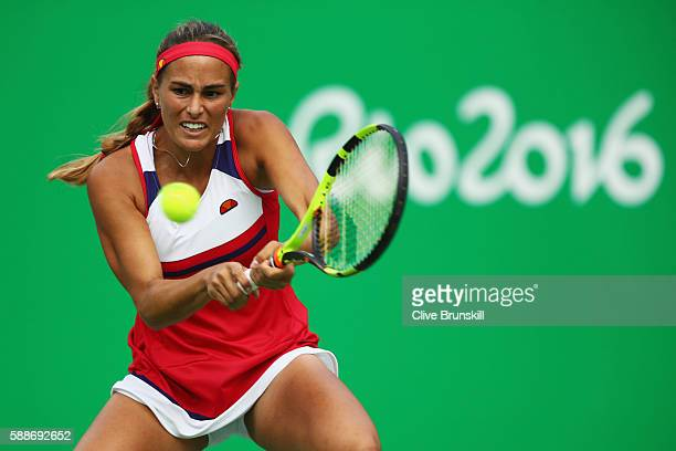 Monica Puig of Puerto Rico returns a backhand against Petra Kvitova of the Czech Republic during the Women's Singles Semifinal on Day 7 of the Rio...