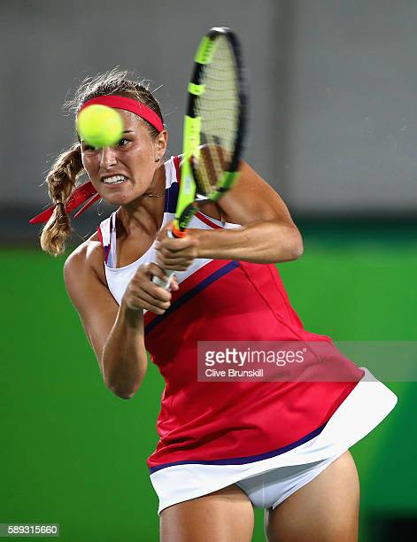 Monica Puig of Puerto Rico returns a shot against Angelique Kerber of Germany during the Women's Singles Gold Medal Match on Day 8 of the Rio 2016...
