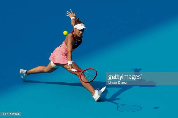 Monica Puig of Puerto Rico returns a shot against Zheng Saisai of China during women's singles first round match of 2019 China Open on September 28,...