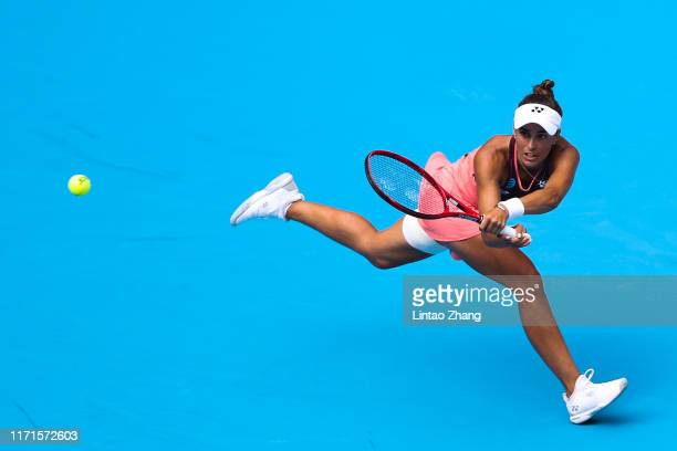 Monica Puig of Puerto Rico returns a shot against Zheng Saisai of China during women's singles first round match of 2019 China Open on September 28...