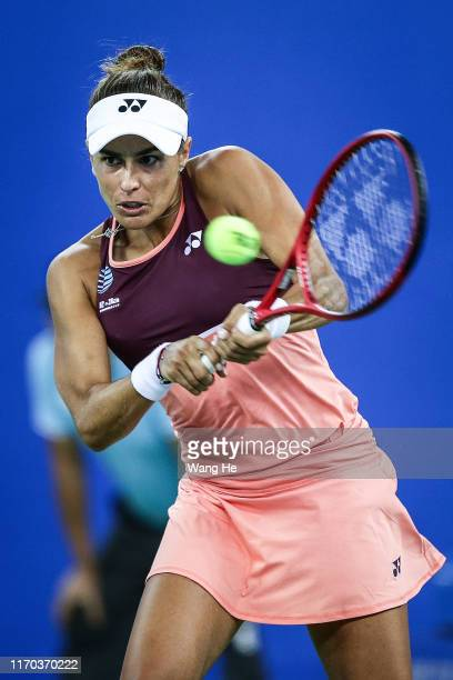 Monica Puig of Puerto Rico returns a shot during the match against Angelique Kerber of Germany on Day 2 of 2019 Dongfeng Motor Wuhan Open at Optics...