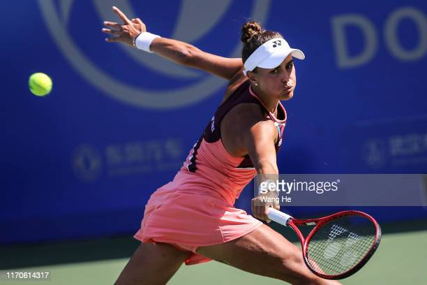Monica Puig of Puerto Rico returns a shot during the match against Alison Riske of USA on Day 3 of 2019 Dongfeng Motor Wuhan Open at Optics Valley...