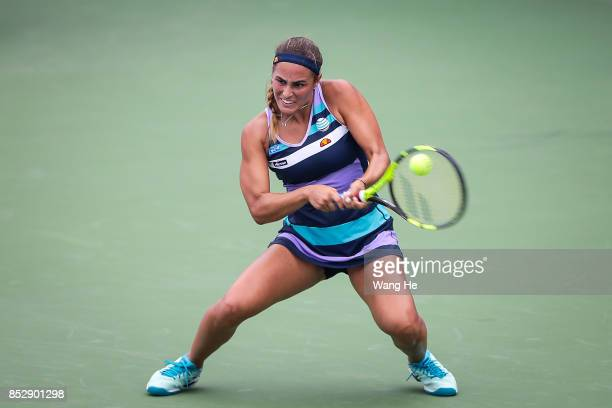 Monica Puig of Puerto Rico returns a shot during the match against Mona Barthel of Germany on Day 1 of 2017 Dongfeng Motor Wuhan Open at Optics...