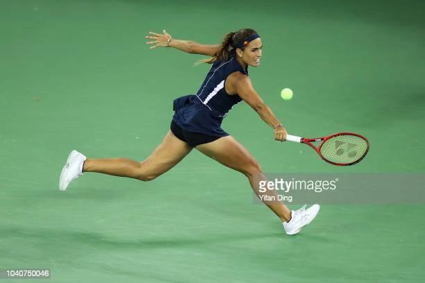 Monica Puig of Puerto Rico returns a shot during women's singles third round match against Caroline Wozniacki of Denmark of the WTA Wuhan Open tennis...