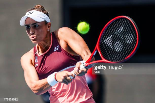 Monica Puig of Puerto Rico returns a shot in the Women's Singles first round match against Zheng Saisai of China on Day one of 2019 China Open at the...