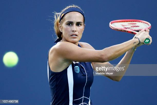Monica Puig of Puerto Rico returns a shot to Anett Kontaveit of Estonia during Day 3 of the Connecticut Open at Connecticut Tennis Center at Yale on...