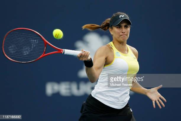 Monica Puig of Puerto Rico returns a shot to Xiyu Wang of China during the Miami Open Presented by Itau at Hard Rock Stadium on March 20 2019 in...