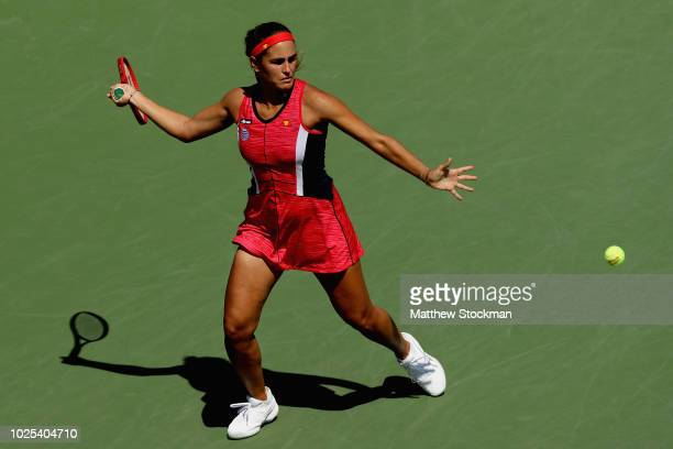Monica Puig of Puerto Rico returns the ball during her women's singles second round match against Caroline Garcia of France on Day Four of the 2018...