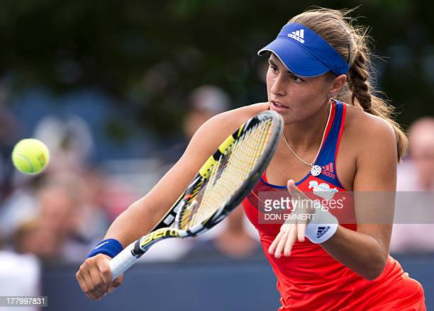 Monica Puig of Puerto Rico returns to Alisa Kleybanova during their US Open 2013 women's singles match at the USTA Billie Jean King National Center...