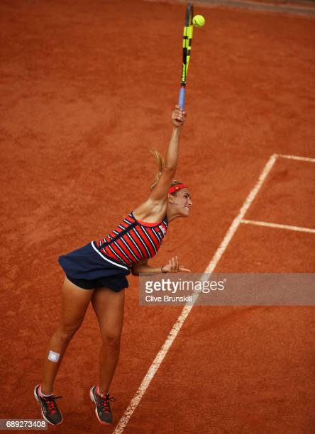 Monica Puig of Puerto Rico serves during the ladies singles first round match against Roberta Vinci of Italy on day one of the 2017 French Open at...