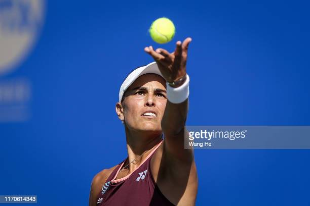 Monica Puig of Puerto Rico serves during the match against Alison Riske of USA on Day 3 of 2019 Dongfeng Motor Wuhan Open at Optics Valley...