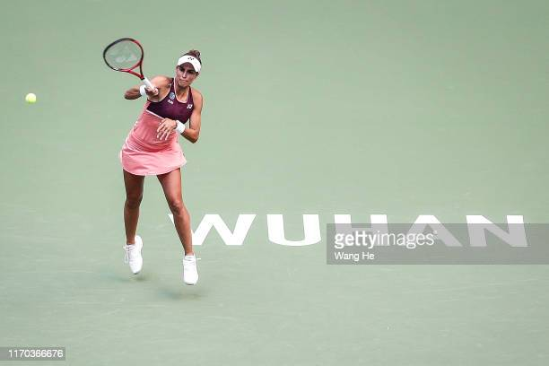 Monica Puig of Puerto Rico serves during the match against Angelique Kerber of Germany on Day 2 of 2019 Dongfeng Motor Wuhan Open at Optics Valley...
