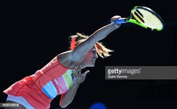 Monica Puig of Puerto Rico serves in her first round match against Samantha Stosur of Australia on day one of the 2018 Australian Open at Melbourne...
