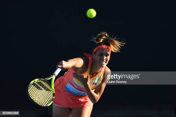 Monica Puig of Puerto Rico serves in her second round match against Kaia Kanepi of Estonia on day three of the 2018 Australian Open at Melbourne Park...