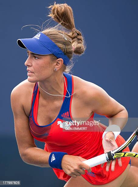 Monica Puig of Puerto Rico serves to Alisa Kleybanova during their US Open 2013 women's singles match at the USTA Billie Jean King National Center...