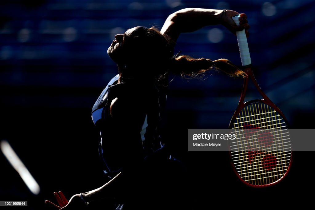 Monica Puig of Puerto Rico serves to Caroline Garcia of France returns a shot to during Day 4 of the Connecticut Open at Connecticut Tennis Center at Yale on August 23, 2018 in New Haven, Connecticut.