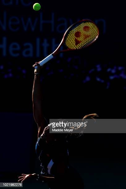 Monica Puig of Puerto Rico serves to Caroline Garcia of France during Day 4 of the Connecticut Open at Connecticut Tennis Center at Yale on August 23...