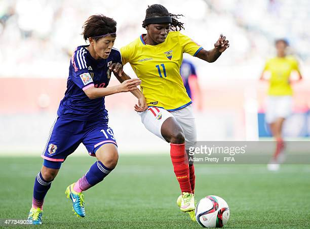 Monica Quinteros of Ecuador is challenged by Saori Ariyoshi of Japan during the FIFA Women's World Cup 2015 Group C match between Ecuador and Japan...