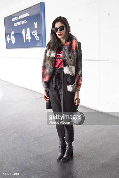Monica Rojas wears Zara boots Zara pants Zara coat Asos shirt Vintage sunglasses Topshop Jacket and Fred Perry handbag during Mercedes Benz Fashion...