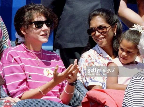 Monica Seles makes her first public appearance during the Arthur Ashe AIDSTennis Challenge 29 August 1993 joining Ashe's widow Jeanne Moutoussammy...