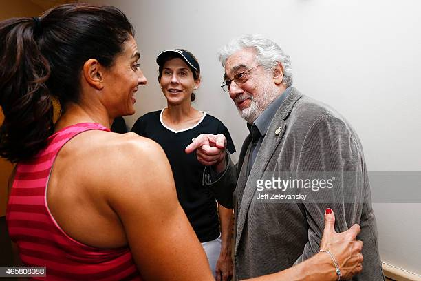 Monica Seles of the United States and Gabriela Sabatini of Argentina greet opera singer Placido Domingo during the BNP Paribas Showdown at Madison...