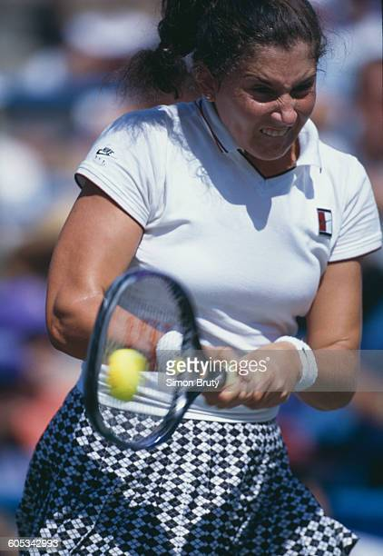 Monica Seles of the United States makes a double back hand return against Conchita Martínez during their Women's Singles Semi Final match of the US...