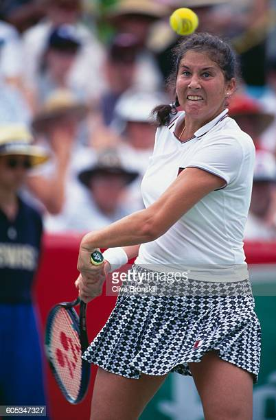Monica Seles of the United States makes a double back hand return against Lindsay Davenport during their Women's Singles Final of the Peters...