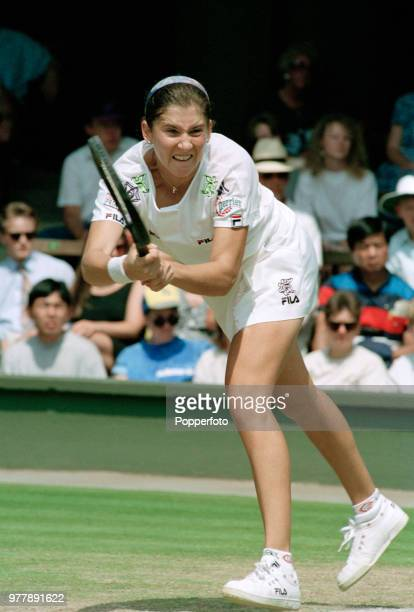 Monica Seles of the United States returns the ball against Gigi Fernandez of the United States during the Ladies Singles fourth round on day six of...