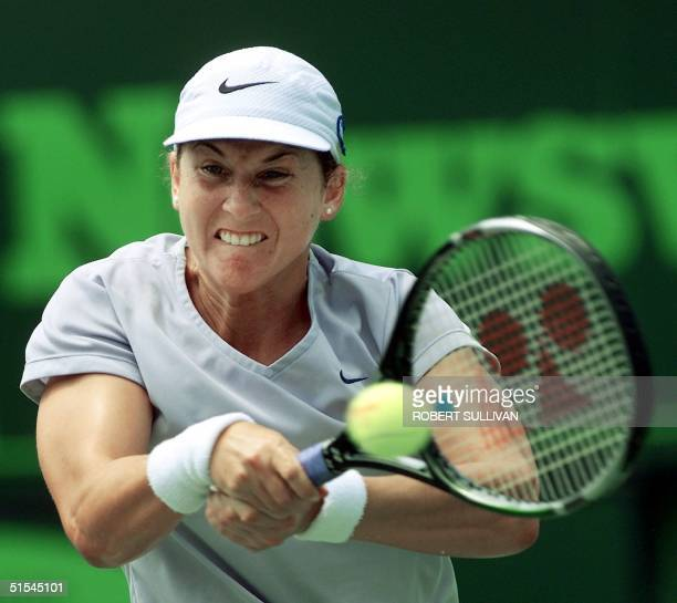 Monica Seles of the US return a backhand to Martina Hingis of Switzerland in their semifinal match 30 March at the Ericsson Open on Key Biscayne FL...