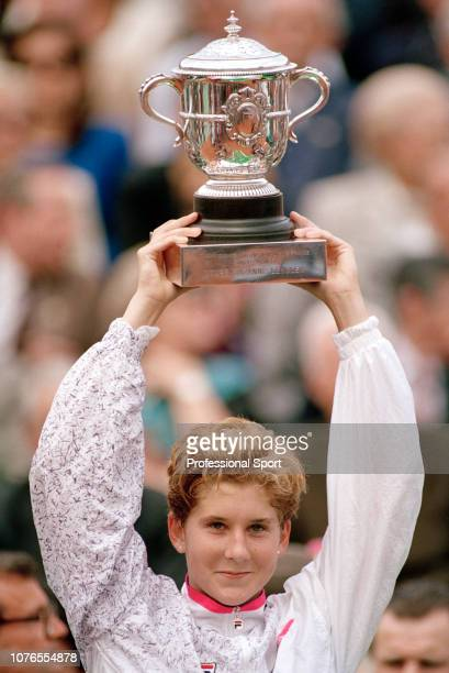 Monica Seles of Yugoslavia celebrates with the Coupe Suzanne Lenglen after winning the women's singles final against Arantxa Sanchez Vicario of Spain...