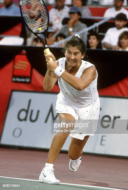 Monica Seles of Yugoslavia hits a return during a women's singles match at the Du Maurier Canadian Open circa 1995 at the Jarry Stadium in Montreal...