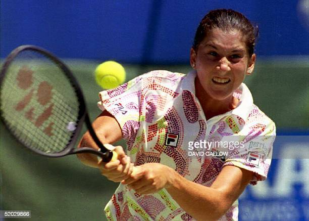 Monica Seles of Yugoslavia hits a twohanded forehand en route to capturing her third consecutive Australian Open title 30 January 1993 in Melbourne...