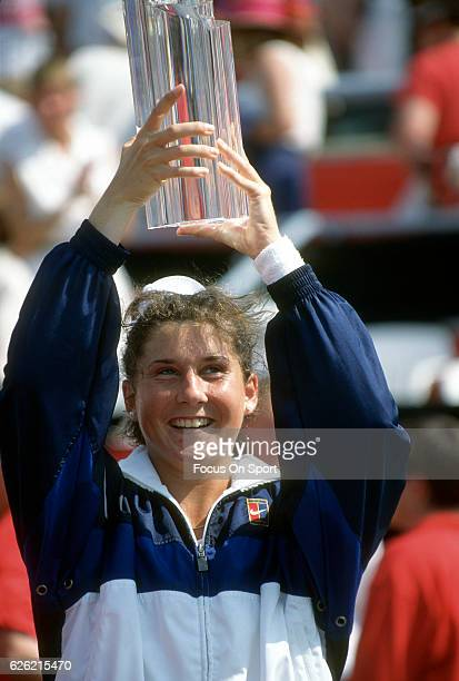 Monica Seles of Yugoslavia holds up the trophy after winning the women's championship of the Du Maurier Canadian Open circa 1995 at the Jarry Stadium...