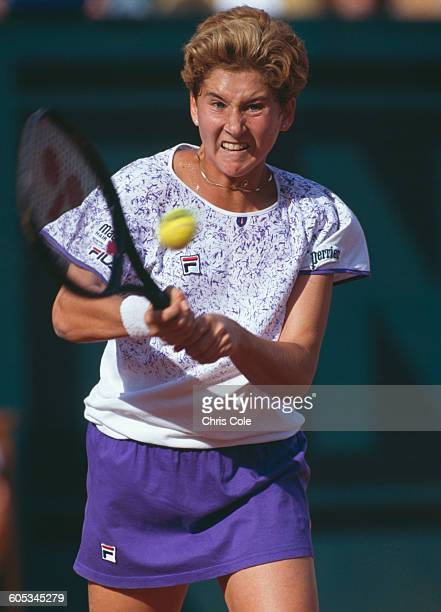 Monica Seles of Yugoslavia makes a double back hand return during the Women's Singles Final match against Arantxa Sanchez Vicario at the French Open...