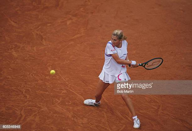 Monica Seles of Yugoslavia makes a double back hand return during the Women's Singles Final match against Steffi Graf at the French Open Tennis...