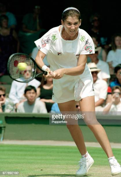 Monica Seles of Yugoslavia returns the ball against Gigi Fernandez of the United States during the Ladies Singles fourth round on day six of the 1992...