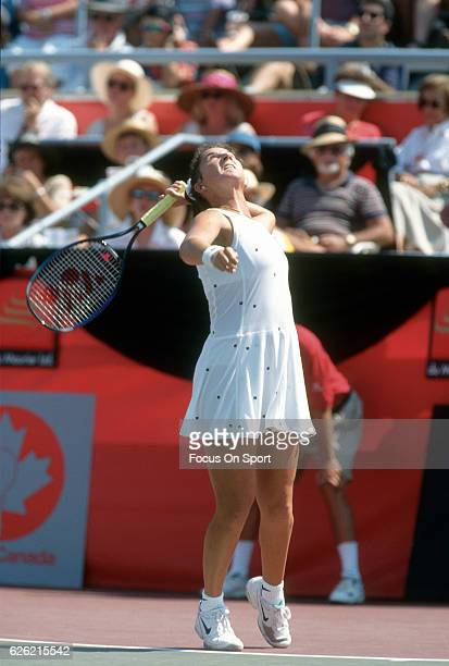 Monica Seles of Yugoslavia serves during a women's singles match at the Du Maurier Canadian Open circa 1995 at the Jarry Stadium in Montreal Quebec...