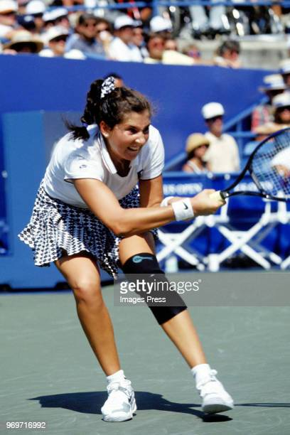 Monica Seles plays tennis during the 1995 US Open in New York City
