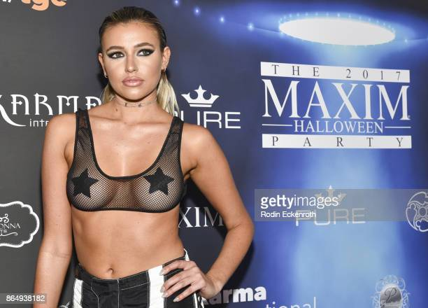 Monica Sims arrives at the 2017 MAXIM Halloween Party at LA Center Studios on October 21 2017 in Los Angeles California
