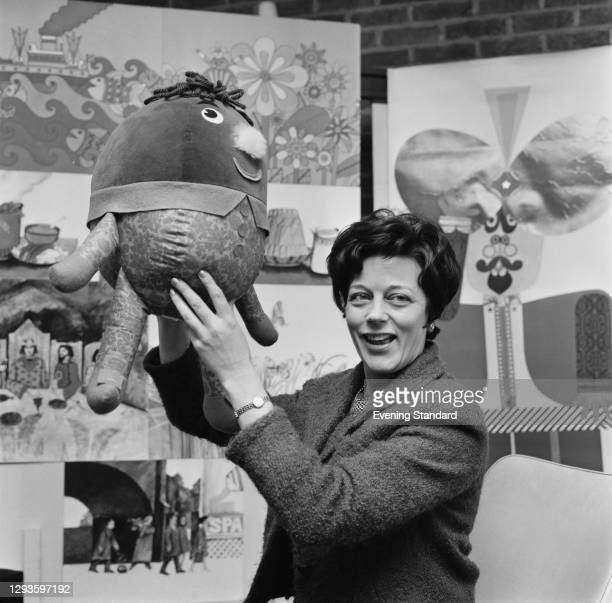Monica Sims , Head of Children's Programmes at BBC Television, holding the soft toy Humpty from the show 'Play School', UK, February 1968.