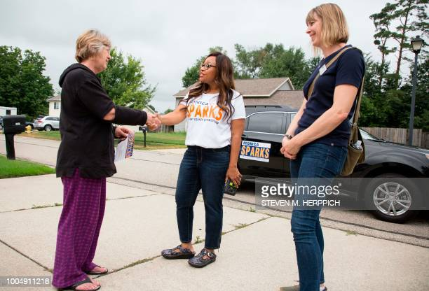 Monica Sparks meets District 12 resident Lynn Paratt while knocking on doors with friend and Kentwood City Commissioner Emily Bridson on July 21 2018...