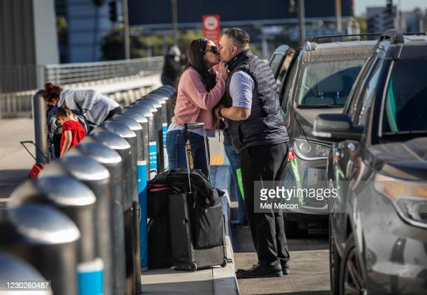 Monica Thomas of Rancho Palos Verdes kisses her husband Mike, a pilot for Southwest Airlines, goodbye after dropping him off outside the terminal....