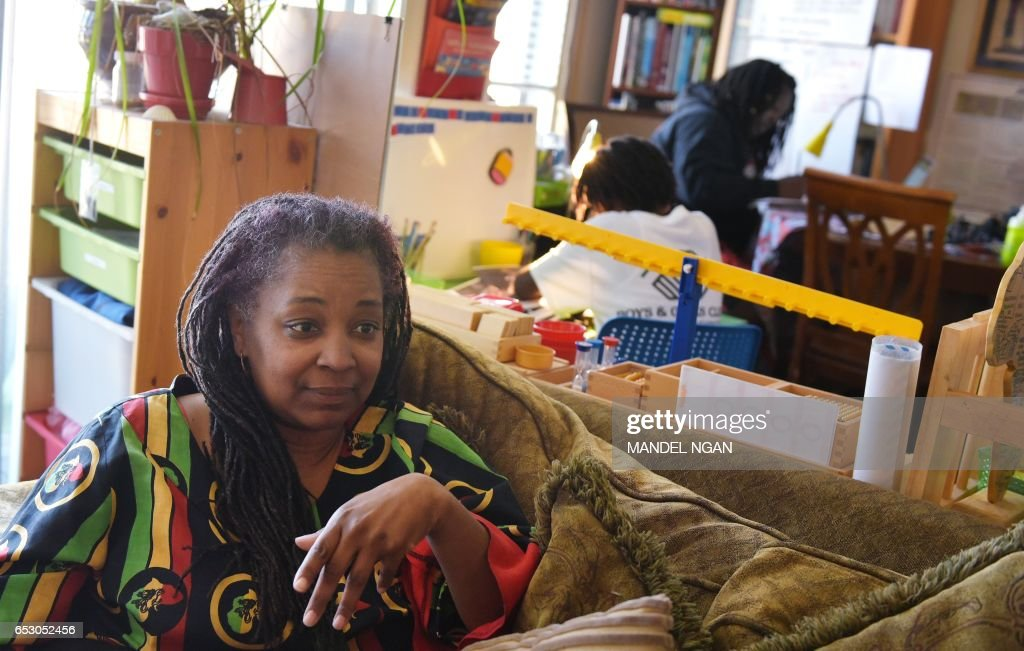 Monica Utsey, 49, who homeschools her children, speaks during an interview at her apartment in Washington, DC on February 24, 2017. / AFP PHOTO / MANDEL NGAN / With AFP Story by Margaret