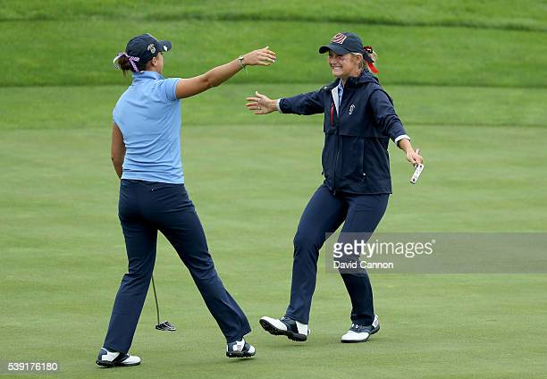 Monica Vaughn and Bailey Tardy of the United States celebrate winning their match by one hole on the 18th green against Meghan MacLaren and Maria...