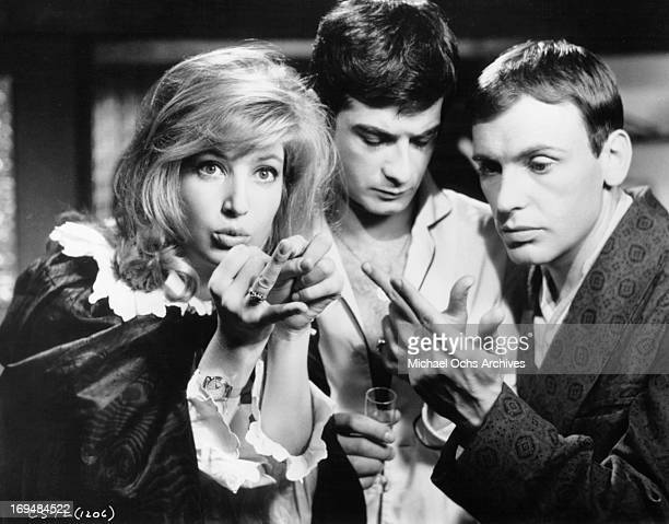 Monica Vitti JeanClaude Brialy and JeanLouis Trintignant in a scene from the film 'Nutty Naughty Chateau' 1963