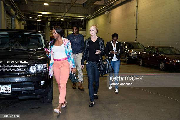 Monica Wright Amber Harris Rachel Jarry and Ta'Shauna Sugar Rodgers of the Minnesota Lynx arriving before Game 1 of the 2013 WNBA Finals on October 6...